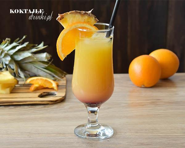 Drink z wódką Exotic Summernight z połączenia dwóch soków ananasowego i pomarańczowego. Z efektem wschodu słońca z grenadyną na dnie.